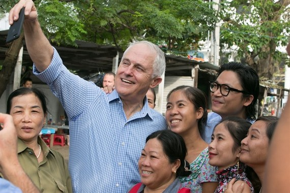 Australian Prime Minister Malcolm Turnbull takes a selfie with local residents in Danang