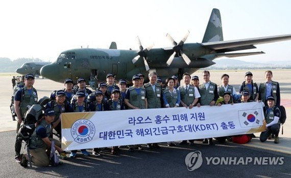 A South Korean disaster relief team comprising medical personnel leaves for Laos on July 29, 2018, to support recovery efforts for the deadly flooding that resulted from the collapse of a dam that was under construction by a Korean builder. (pool photo) (
