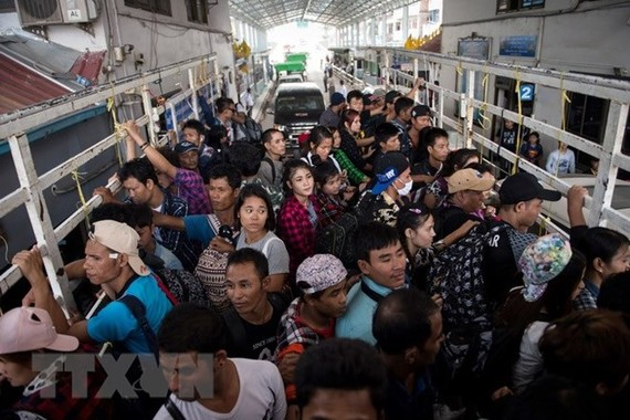 Foreign migrant workers in Thailand (Photo: AFP/VNA)