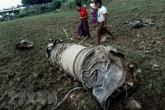 The scene of the military jet fighters crash in the central Magway region, Myanmar, on October 16 (Photo: AFP/VNA)