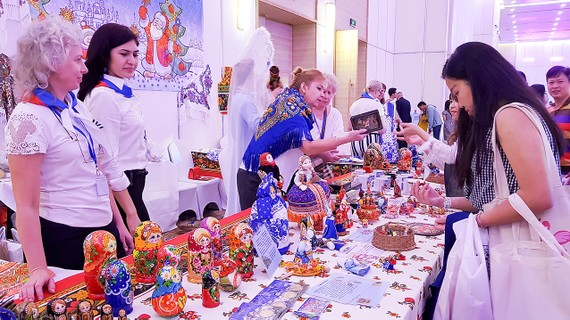 Visitors buy Russian traditional products at The Russian Consulate General in HCMC's booth