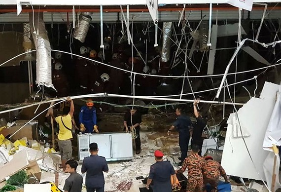 Malaysian security personnel inspect the site after an explosion at the City One Megamall in Kuching, the capital city of Sarawak state, on December 4 (Source: AFP)