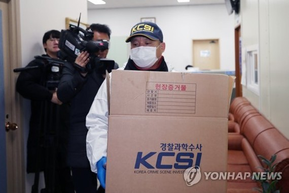 An officer from Korea Crime Scene Investigation works at Haenam Police Station in the southwestern town of Haenam, South Jeolla Province, on Dec. 28, 2018, after a suspect detained on suspicion of murdering a man killed himself inside a bathroom at a cell
