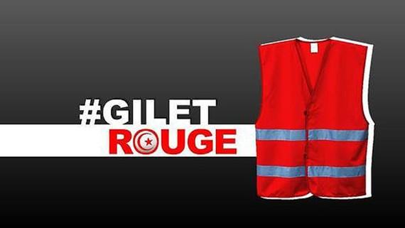 Mẫu áo đỏ chuẩn bị cho cuộc biểu tình sắp tới ở Tunisia. Ảnh: ANSA