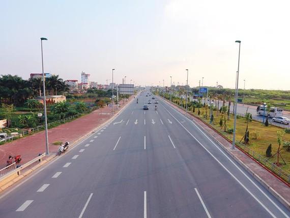 Đại lộ Võ Nguyên Giáp đã giảm nửa quãng đường ra Sân bay Nội Bài, giúp tăng sức thu hút đầu tư cho Hà Nội.