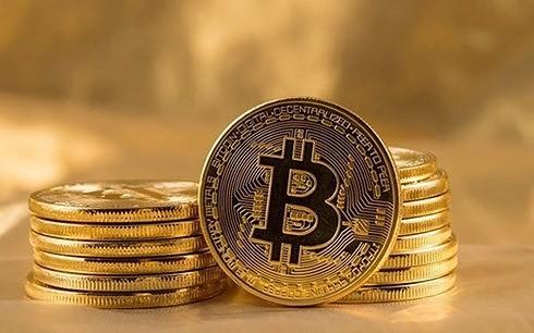 Chuyên gia cho rằng, quản lý quan trọng hơn tìm cách cấm giao dịch Bitcoin. (Ảnh minh họa: KT)