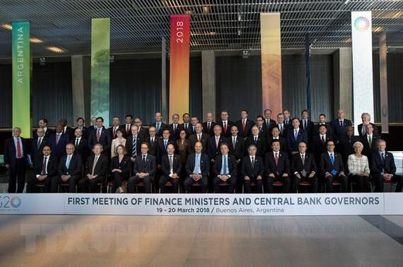 Bộ trưởng Tài chính và Thống đốc Ngân hàng trung ương các nền kinh tế thành viên G20 chụp ảnh chung tại hội nghị. (Nguồn: THX/TTXVN)