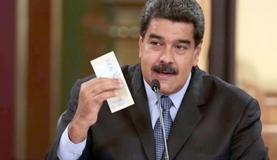 Tổng thống Marudo và tờ Bolivar mệnh giá mới, được công bố thông qua đài truyền hình quốc gia. ẢNH:  AFP/Getty Images