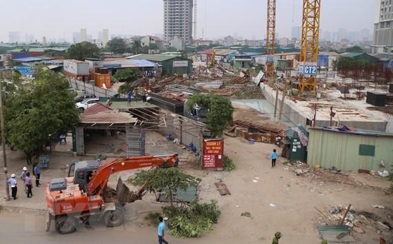 Mặt bằng đang bị cưỡng chế để xây dựng khu tái định cư Tây Nam Kim Giang nhìn từ trên cao. (Ảnh Mạnh Khánh/TTXVN)