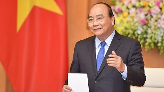 Thủ tướng Nguyễn Xuân Phúc phát biểu tại cuộc gặp. Ảnh: VGP/Quang Hiếu