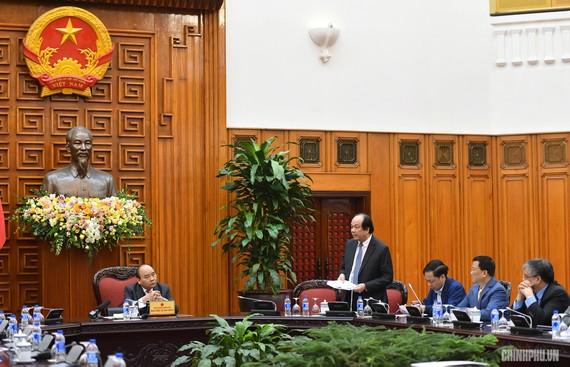 Bộ trưởng, Chủ nhiệm VPCP Mai Tiến Dũng báo cáo Thủ tướng tại cuộc họp. - Ảnh: VGP/Quang Hiếu