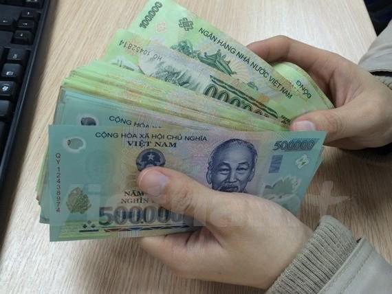 Bộ Tài chính đề nghị các địa phương cân đối ngân sách để trả nợ đúng hạn. (Nguồn: Vietnam+)