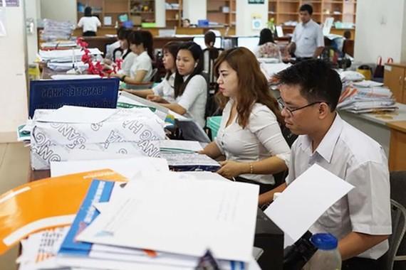 Gác chặt nguồn tăng thu để cải cách tiền lương