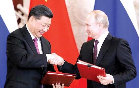 Lãnh đạo Nga - Trung Quốc quyết tâm phát triển quan hệ Đối tác toàn diện Ảnh: Reuters