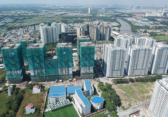 Many housing projects are under construction in Nha Be District in Ho Chi Minh City. (Photo: SGGP)