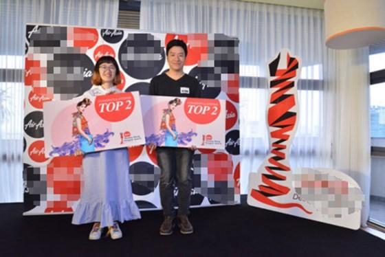 Ngo Hoang Kha (R) and Tran Thi Tu