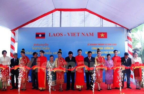 Scene at the ceremony to transfer the printing factory (Photo: VNA)