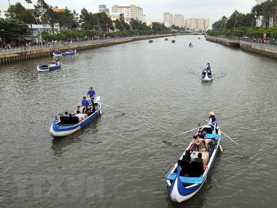 Tourist boats on Nhieu Loc-Thi Nghe canal in HCM City (Photo: VNA)