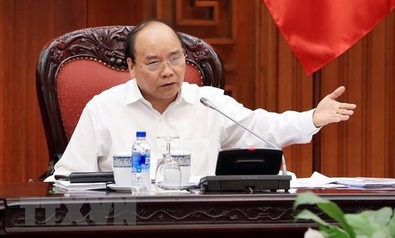 Prime Minister Nguyen Xuan Phuc addresses the meeting (Photo: VNA)