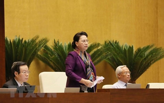 National Assembly Chairwoman Nguyen Thi Kim Ngan (standing) said the NA always listens to opinions from people about draft laws deliberated at the legislature and calls on people nationwide to trust the Party and State (Photo: VNA)
