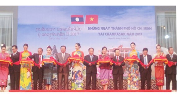 Leaders from Ho Chi Minh City and Champasak province cut a ribbon to open the Ho Chi Minh City Days in Champasak 2017.
