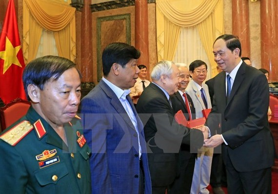 President Tran Dai Quang met with Vietnamese former volunteer soldiers who helped Cambodia in the 1979-1989 period. (Photo: VNA)