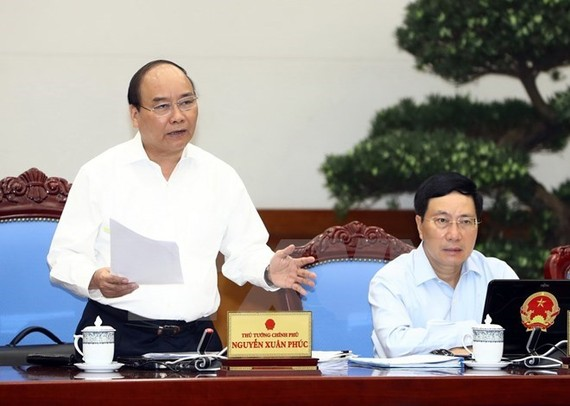 Prime Minister Nguyen Xuan Phuc speaks at the Government's meeting for July on August 3 (Photo: VNA)