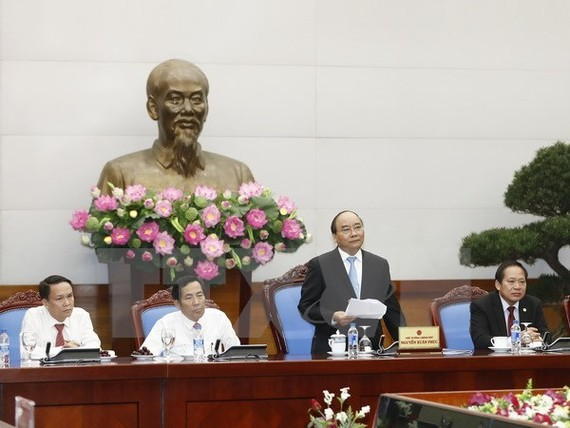  Prime Minister Nguyen Xuan Phuc speaks at a meeting with leaders of press agencies on June 18 (Photo: VNA)