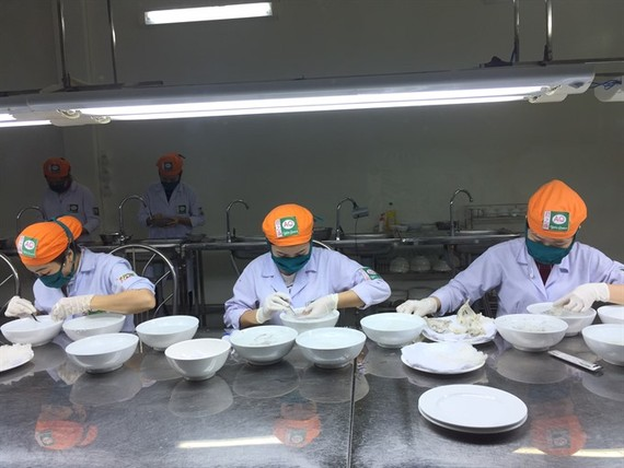 Preliminary processing of swift nests at a bird nest production company in HCM City's Can Gio district (Source: VNA)