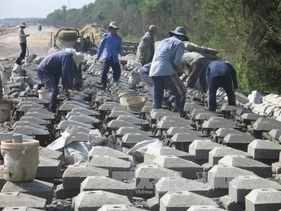 A section of Go Cong sea dike under reinforcement (Source: VNA)