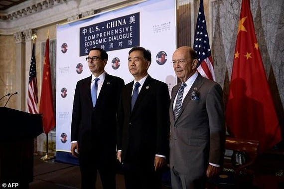 Treasury Secretary Steven Mnuchin, Chinese Vice Premier Wang Yang and Commerce Secretary Wilber Ross (left to right) open trade talks, with the US officials demanding more 'fair and reciprocal' trade with China. — AFP/VNA