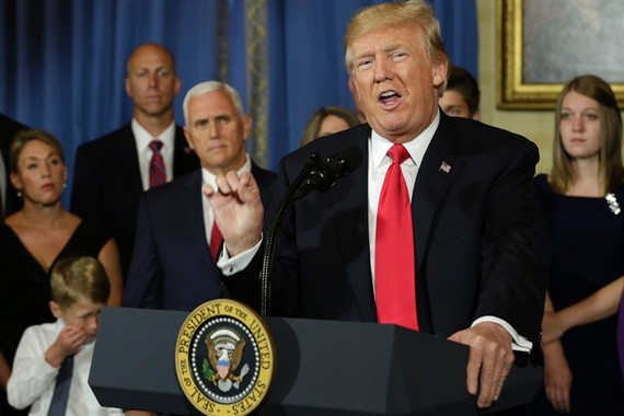 "US President Donald Trump delivers s statement on healthcare in front of alleged ""victims of Obamacare"" at the White House in Washington on July 24. — AFP/VNS"
