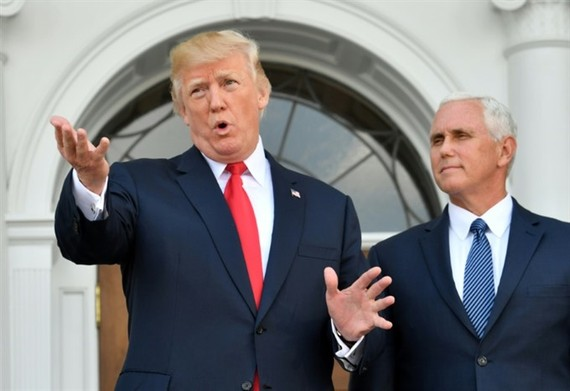 US President Donald Trump, with Vice President Mike Pence to his right, has more tough words for North Korea. — AFP/VNA
