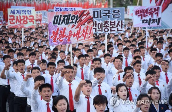 This file photo released by the Korean Central News Agency on Sept. 24, 2017, shows North Koreans holding a mass anti-U.S. rally in Pyongyang on Sept. 23, 2017. (Yonhap)