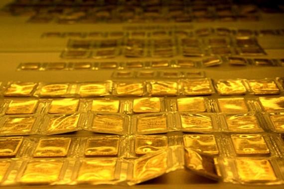 Giá vàng thế giới lên sát ngưỡng 1.300 USD/ounce