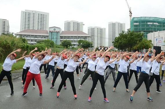 """Thể dục đồng diễn với chủ đề """"Phụ nữ khỏe, đẹp, tự tin"""" tại TPHCM"""
