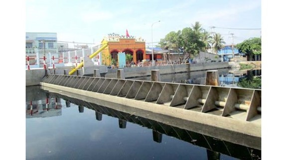 Tide control culvert system in Nhay and Ruot Ngua canals, ward 16, District 8, HCMC (Photo: SGGP)