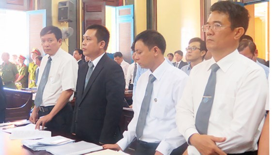 Lawyers participate in the proceedings at a court