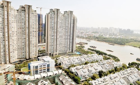 Real estate market is on strongly developing trend. The photo shows buildings in HCMC (Photo: SGGP)