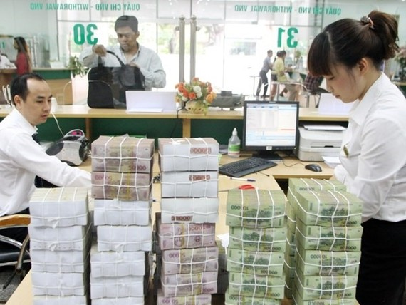 The central bank on Friday held an online conference to prepare for the implementation of the scheme to settle non-performing loans (NPL) and restructure credit institutions in the 2016-20 period. (Photo: vietcombank.com.vn)