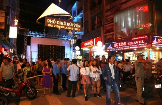 Visitors at Bui Vien walking street which was officially opened in HCMC on August 20 (Photo: SGGP)