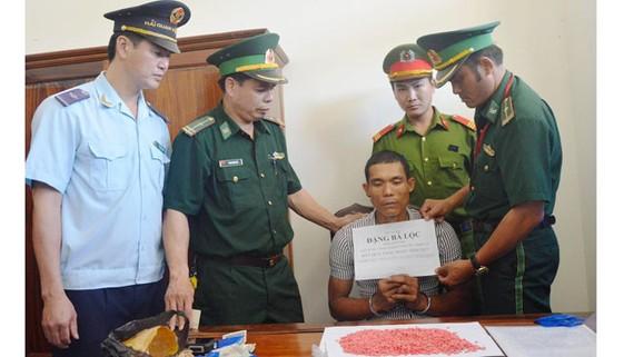 Đối tượng Đặng Bá Lộc bị bắt cùng tang vật