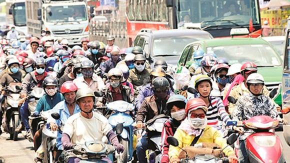 People poured into HCMC on National Way No.1 on May 1 after their long holiday. Photo by Cao Thang