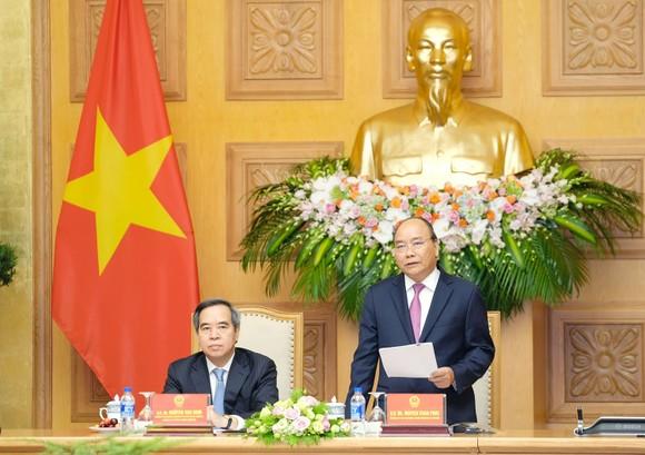 政府總理阮春福同與會代表會晤時發表講話。(圖源:光孝)