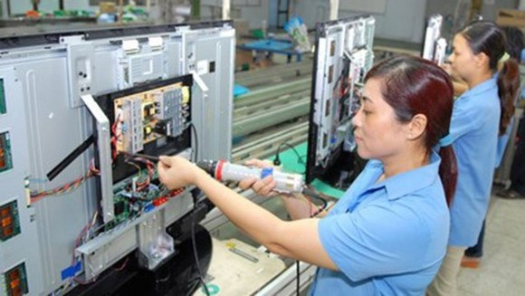 Electronics and information technology is one of four key industries posting high growth rate in the first half of 2017 (Photo: SGGP)