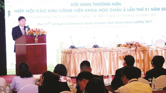Chairman Nguyen Thanh Phong states at the conference (Photo: SGGP)