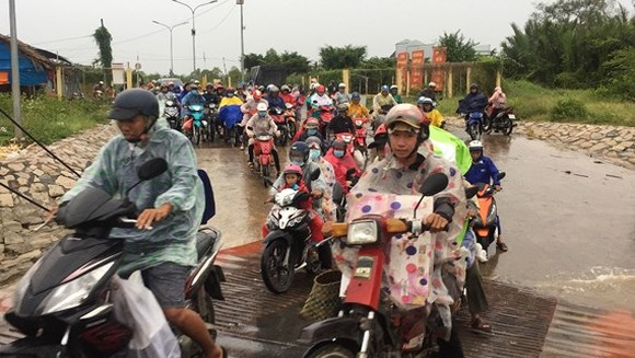 Many places in Tien Giang province  started seeing wide spread rain on December 25 (Photo: SGGP)