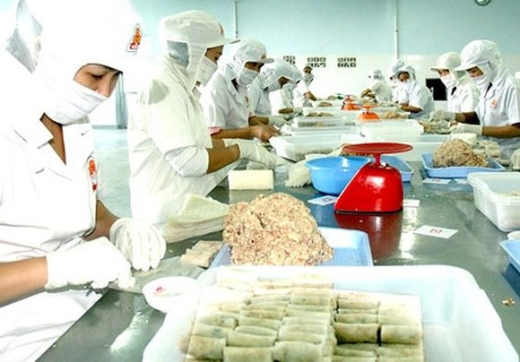 Businesses are concentrating on production for the Tet holiday (Photo: SGGP)