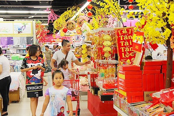 Supermarkets will increase opening time by 2-4 hours in days near the Tet holiday (Photo: SGGP)