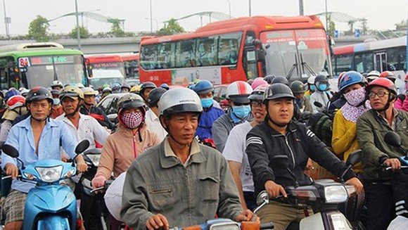 A traffic jam stretches over 10 kilometers in Highway N2, Bến Lức district, Long An province in the photo taken from Minh Hai's Facebook posting